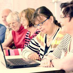 Older people learning on laptop